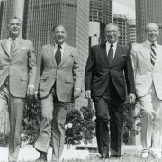 Detroit business and community leaders, left to right, Robert Surdam, Henry Ford II, Max Fisher, and Robert McCabe in front of the Renaissance Center, late 1970s.