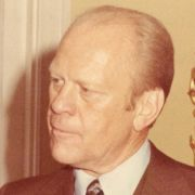 Max M. Fisher and President Gerald Ford greet each other.