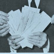 A blue pamphlet declares the United Jewish Appeal is guarantor in loan between 11 U.S. Life Insurance companies and Jewish Agency for Israel, Inc. and shows UJA executives Gottlieb Hammer, Max Fisher, Dewey Stone, and Rabbi Herbert Friedman displays checks worth $50 million.