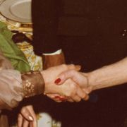 Marjorie Fisher shakes hands with Jihan Sadat, the wife of Eyptian President Anwar Sadat.