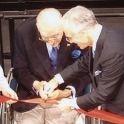 Max Fisher cutting the ribbon for the opening of the Max M. Fisher Music Center in 2003.