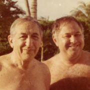 Max Fisher standing with friend beside pool.
