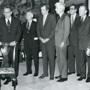 Max Fisher, Gerald Ford and other members of the UJA and the State Department signing the contract in the Thomas Jefferson Room of the State Dept. Building.