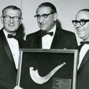 Max Fisher holding his award with Rabbi Maurice N. Eisendrath, president of the American Hebrew Congregations, and Industrialist Lester Avnot.