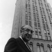 Max Fisher in front of the iconic Fisher Building in Detroit, and in his office on the 22nd floor.