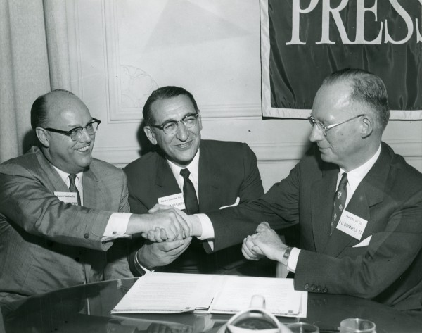 William E. Slaughter and Max M. Fisher of Aurora Gasoline Company with J.C. Donnell II of The Ohio Oil Company.