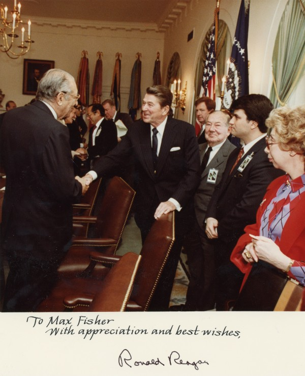A photo of Max M. Fisher with Ronald Reagan, signed by the president.