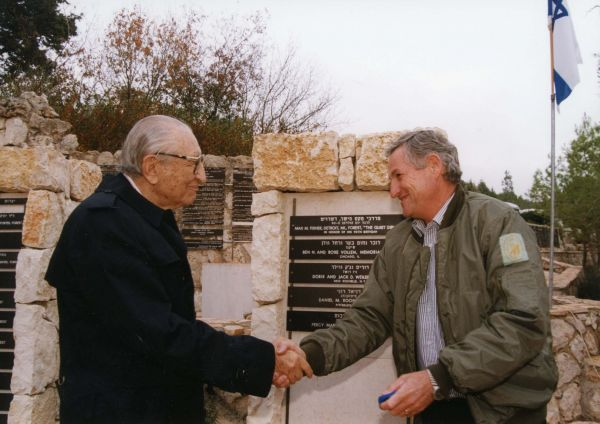 Max Fisher is congratulated by Jewish National Fund world chairman Shlomo Gravitz at the American Independence Park in Israel.