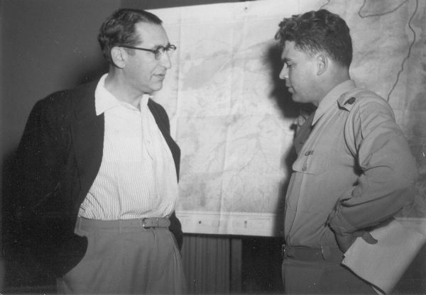 Max Fisher meets with a member of the Israeli Army in Jerusalem in 1954.
