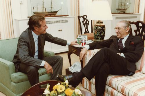Max M. Fisher and George H. W. Bush share a laugh at the White House.