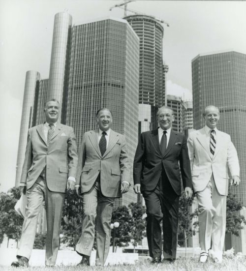 Detroit business and community leaders Robert Surdam, Henry Ford II, Max Fisher, and Robert McCabe in front of the Renaissance Center, late 1970s.