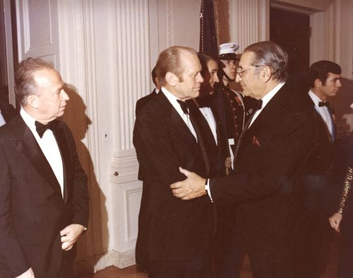 Max Fisher greets President Ford during a White House dinner for Israeli Prime Minister Yitzhak Rabin in 1976.