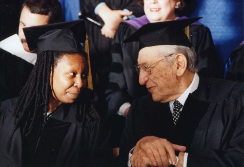 Max Fisher with Whoopi Goldberg at Brandeis University Commencement, May 1997.