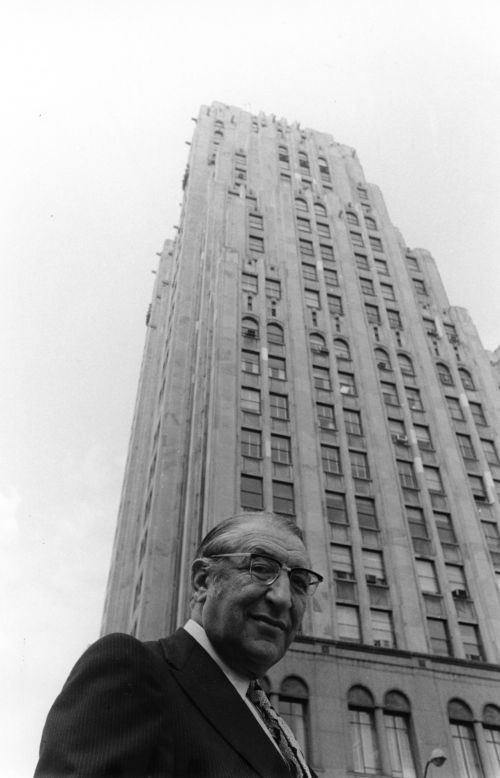 Max Fisher in front of the Fisher building in Detroit.